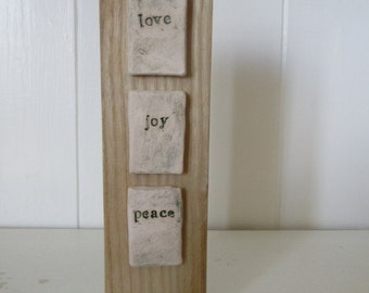 Ceramic words on driftwood - love, joy, peace, Micha 6:8