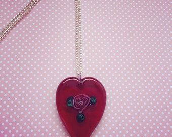 Red galss heart pendent on silver chain