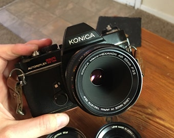 Konica SLR with 28mm, 50mm, and 55mm prime lenses