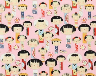 Yui Kokeshi Doll on Pink Cotton Fabric by Alexander Henry