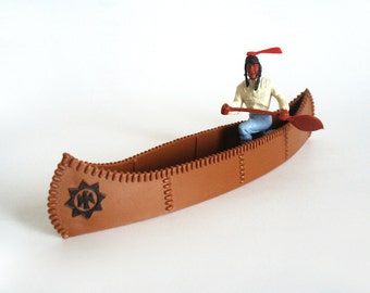 Timpo toys Native American Indian in brown canoe, made in Gt Britain