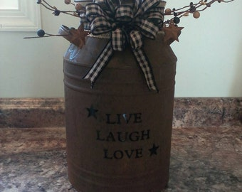 Beautifully decorated rustic milk can. Would look go with all your rustic decor. It can sit on table,counter or shelf.