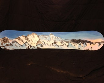 Mountains at sunset on snowboard deck