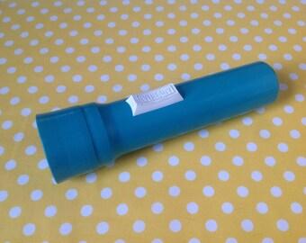 Eveready handheld flashlight, teal / aqua, blue flashlight, plastic