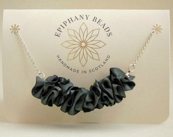 Emblem ~ grey satin ribbon and silver necklace