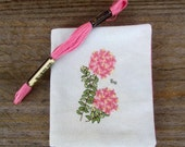 Cross stitch needlebook on pale green coloured linen and pink patterned fabric lining - Pink Rice Flower.