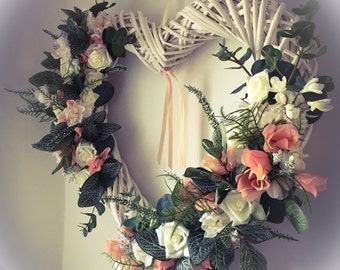 White wicker heart wreath with flowers and greenery, heart wreath, wicker heart, flower wreath, flower heart wreath, wedding display