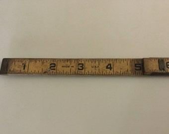 """72"""" Folding ruler."""