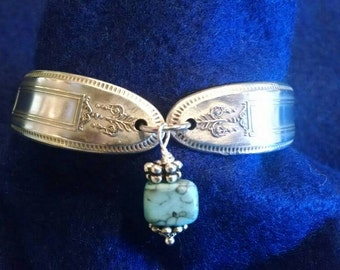 Vintage silverware spoon bracelet. With turquoise bead