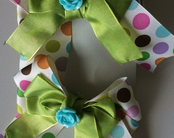 Polka dotted and green flower bow set