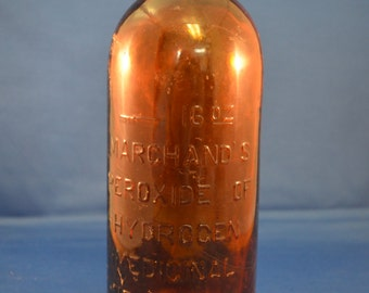 Marchand's brown glass bottle