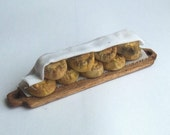 112th scale dolls house miniature handmade Tudor pies on a wooden board