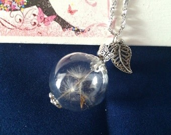 "Delicate Dandelion Seed Necklace, with Butterfly & Leaf Charms on 18"" chain."