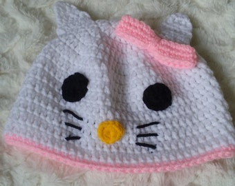 Pretty beanie hat for toddlers one to four years old in white kitten design