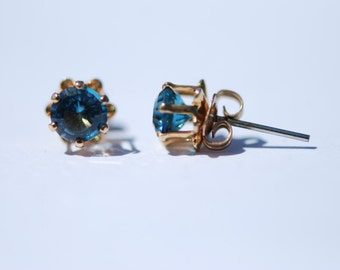 Faceted London Blue Topaz, 5mm round stud earrings. Gold Filled mountings, stainless steel posts