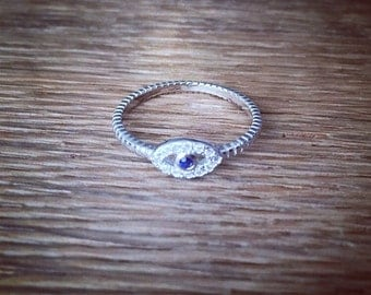 "925 Sterling silver ""Evil eye"" ring with Clear white CZ crystals and Synthetic Blue Sapphire"