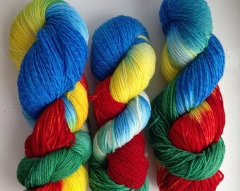 The Superb Rosellas - hand-dyed tweed sock yarn. Two ends Merino wool, one end superwash Merino. 400 metres/432 yards. 100 grams.