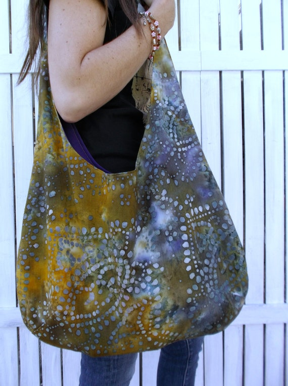 a boho bag full of style in trending fabrics including chevron, paisley, color block, linens, and new for the Fall season flannels, corduroy, and sweater. an over the shoulder large purse in hobo bag style.