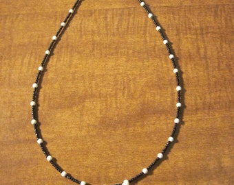 Moonchild - Wolf's tooth and howlite necklace