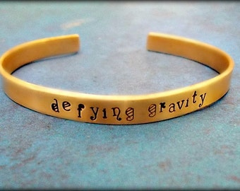 Wicked the Musical Cuff Bracelet, Hand Stamped Defying Gravity, Gold Cuff, Wicked the Musical Jewelry, Available in Brass Aluminum or Copper