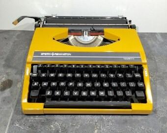 Vintage yellow Sperry-Remington idool typewriter