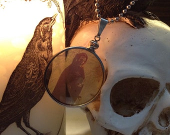 Eerie Grim Reaper Figurine Holding a Crystal Ball  transparent Glass Locket Necklace. Original Transparent Photography. Unique.