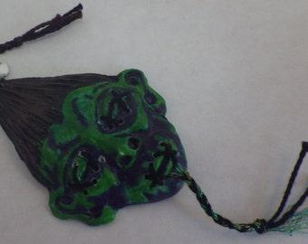 shrunken head bookmark