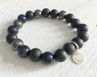 Beaded bracelet with blue goldstone, matte onyx, hematite and sterling silver