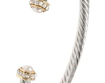 Cable cuff with creamy stone on end with rhinestones