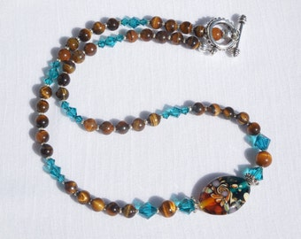 Tigereye and Swarovski crystal necklace with lampworked glass focal