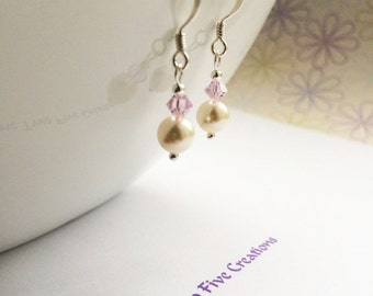 Sterling silver swarovski pearl earrings with a swarovski crystal in pink