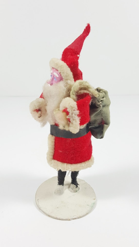 Vintage cloth santa carrying toy sack figurine composition