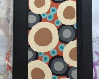 Pebbles Unlined Moleskine Notebook