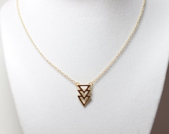 Cute and dainty gold plated triangles necklace.