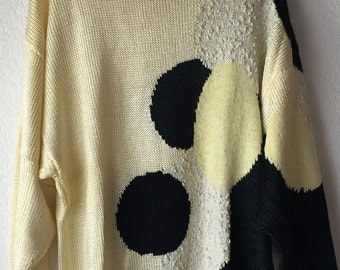 Handmade knitted black and white wool sweater
