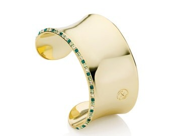 Oxus Envy cuff, soft 14kt gold casing with green Swarovski crystals. Also available in rhodium/black, silver/blue and rose gold/pink.