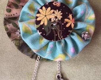 Unique handcrafted Yoyo brooch