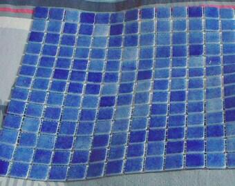 1 plate tesserae mosaic of dark blue glass.
