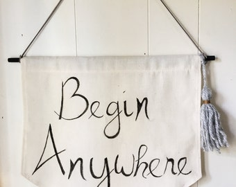 "Quote Banner ""Begin Anywhere"""