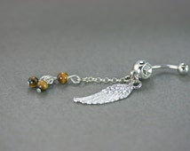 Tiger eye belly botton piercing, Angel wing navel piercing, Belly botton piercing, Belly button rings, Dangle navel jewelry, Navel ring sexy
