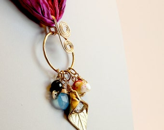 Necklace with cluster of semi precious stones