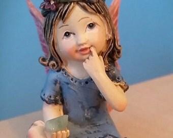 Fairy Child wearing Blue