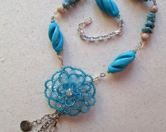 Handmade necklace with turquoise Beads and pearls pendant