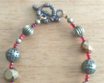 Red and Brass colored earring and bracelet set