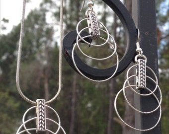 Carefree whimsical triple loop earrings and necklace