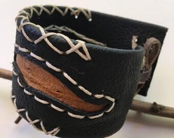 Handmade Leather Cuff Bracelet. Black, yellow & white nylon string.