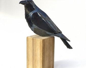 Raven - glazed ceramics on oak