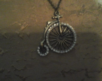 Vintage tricycle long chain costume jewelry
