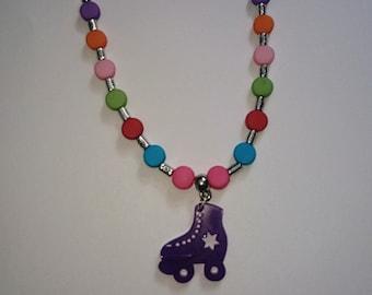 Purple rollerskate necklace