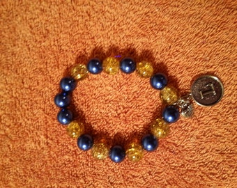 Handmade beaded bracelets with charms